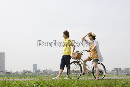 young man walking and young woman