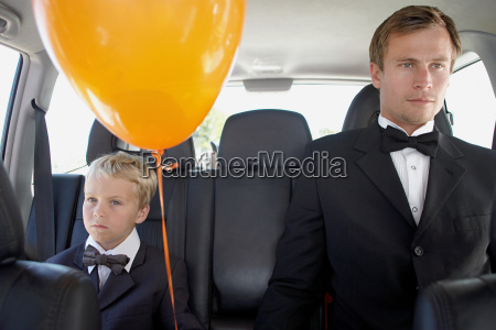 man and boy in a car