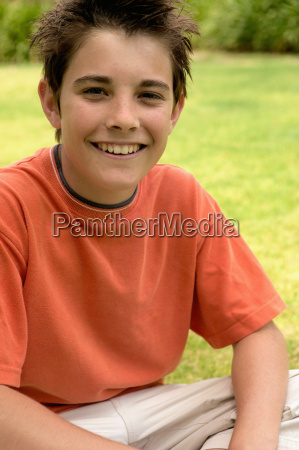 young boy smiling at camera