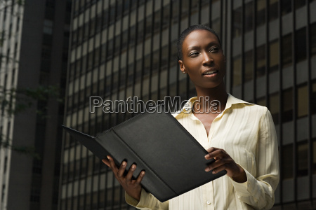 businesswoman looking at a file