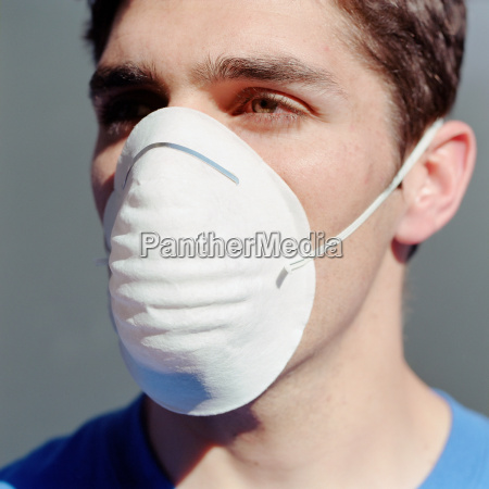 young man wearing a dust mask