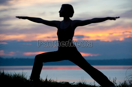 silhouette of woman in warrior yoga