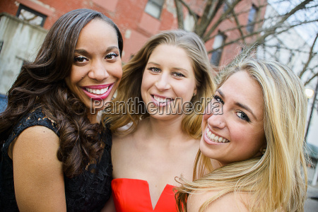 portrait of three glamorous young adult