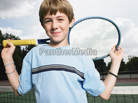 boy holding tennis racket