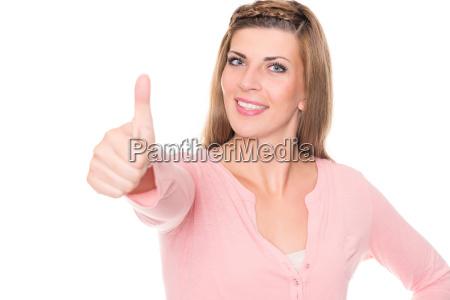mloda kobieta rozciaga kciuki w gore