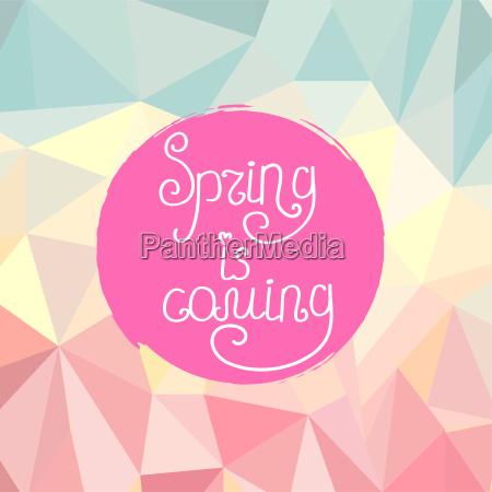 pismo odreczne napis wiosna nadchodzi na