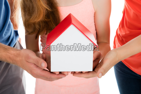 family holding house model