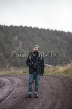 hipster photographer with camera enjoying nature