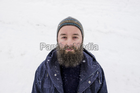 hipster portrait outdoors while enjoying nature