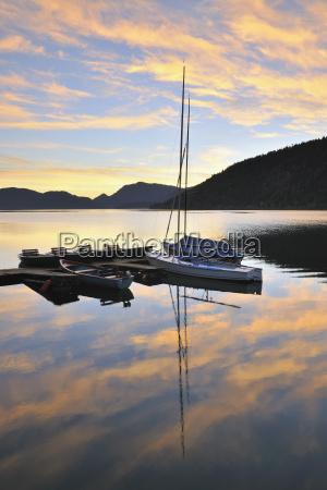 dock and boats at sunrise lake