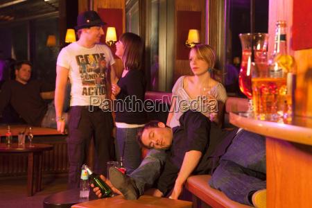 group of people in nightclub dancing