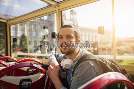 young adult man on bus