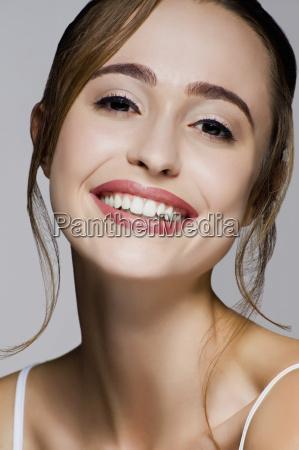 studio portrait of young beautiful smiling