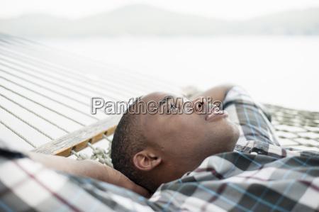 young man lying on hammock