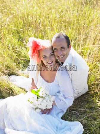 married, couple, sitting, in, a, field - 19474692