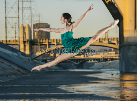 young female dancer leaping in mid