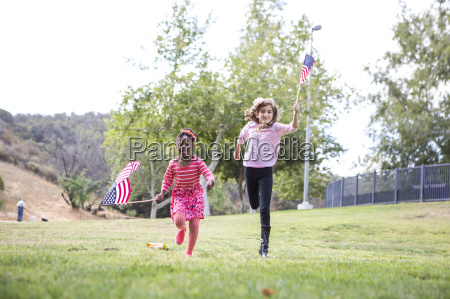 children playing with american flag in