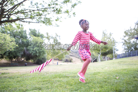girl with american flag playing in