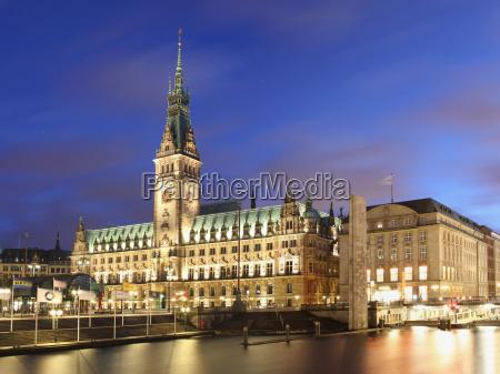ornate urban building lit up at