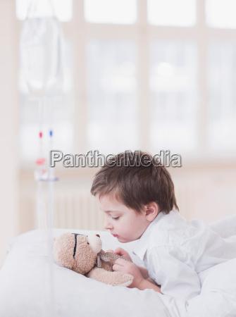 boy lying in bed