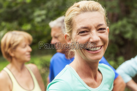 portrait of mature woman outdoors smiling
