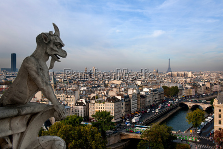 notre dame gargoyle overlooking paris