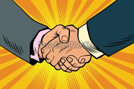 uscisk dloni partnerstwa i pracy zespolowej