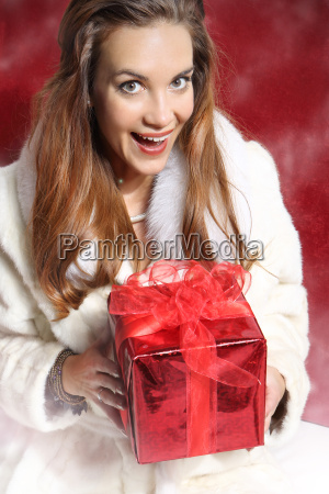 beautiful elegant woman with red gift
