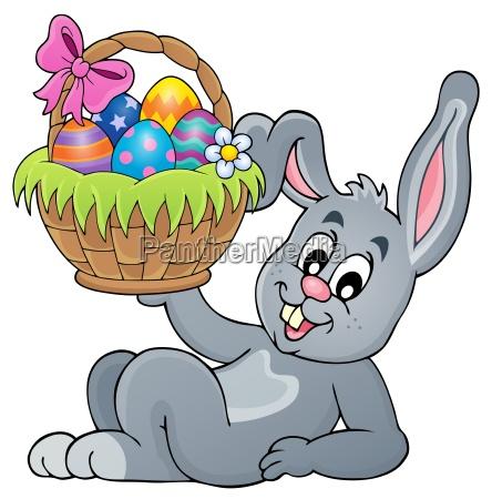 bunny holding wielkanoc basket temat 5
