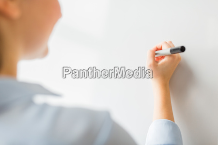 close up of woman writing something