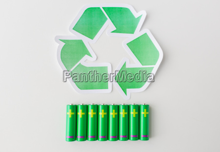 close up of batteries and green