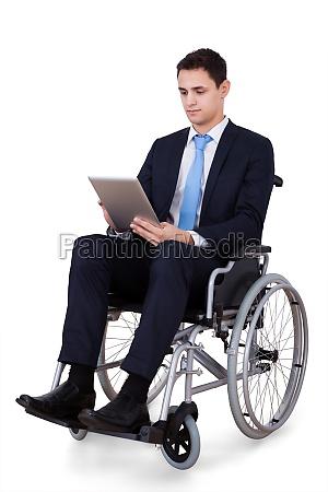 handicapped businessman using digital tablet