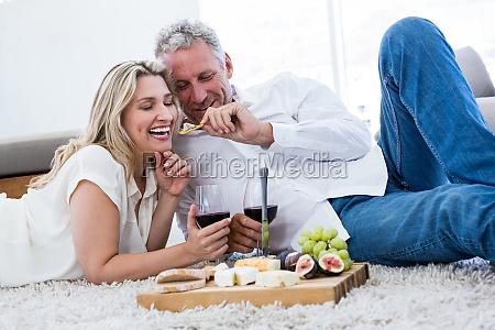 romantic man feeding woman