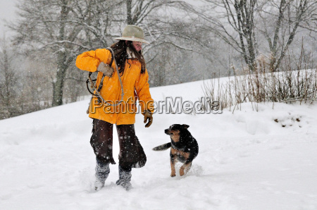 woman walking with her dog walking
