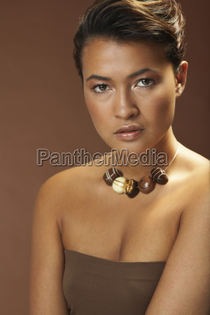 portrait of woman with chocolate necklace
