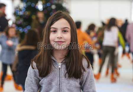 portrait of smiling girl on ice