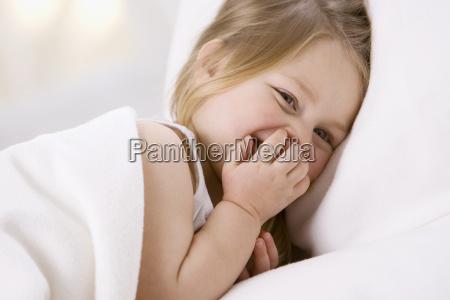 little girl 3 4 smiling whimsically