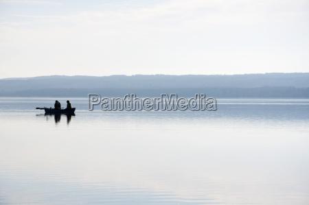 germany bavaria fishermen in boat at