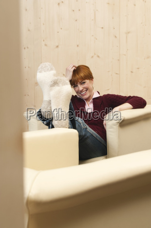 woman sitting in chair smiling portrait