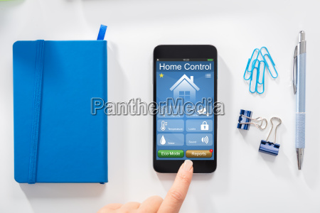 woman using home control application on