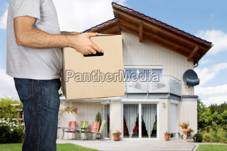 man holding cardboard box in front