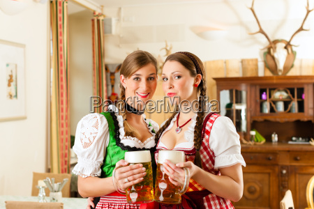 two young women in traditional bavarian