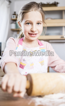 portrait of smiling girl baking in