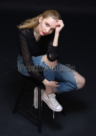 sexy beautiful woman in jeans sitting
