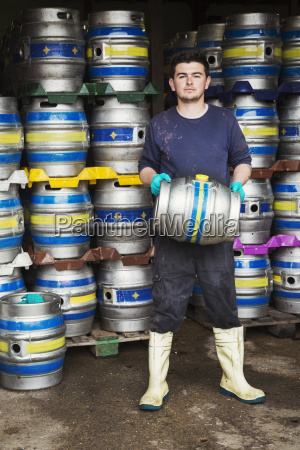 man working in a brewery standing