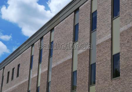 gray brick building windows office facade