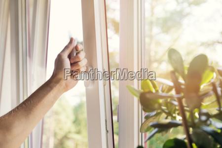 hand open white plastic pvc window