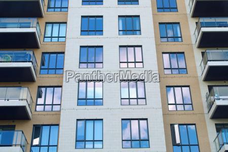 condo skyscraper wall facade windows apartment