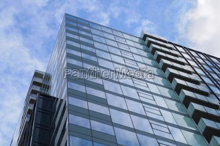 blue glass building corner office business