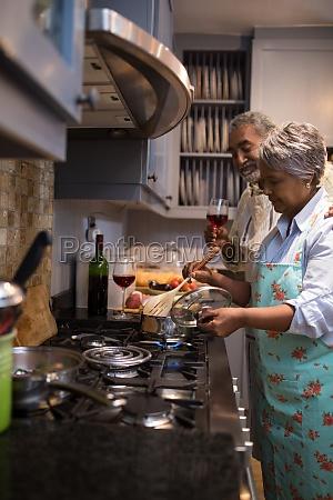 man and woman preparing food at